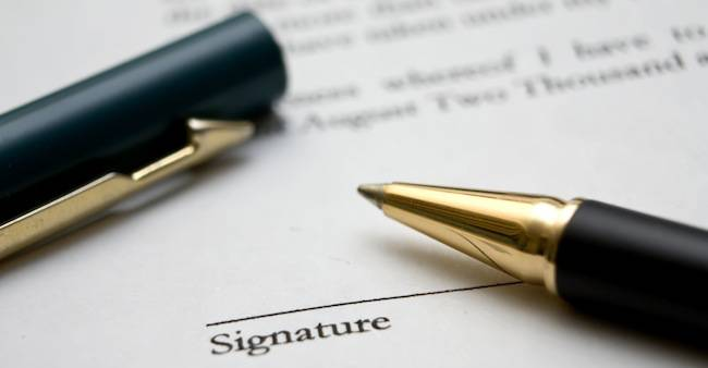 pen-on-a-piece-of-paper-with-signature-policy.740w_derived.jpg
